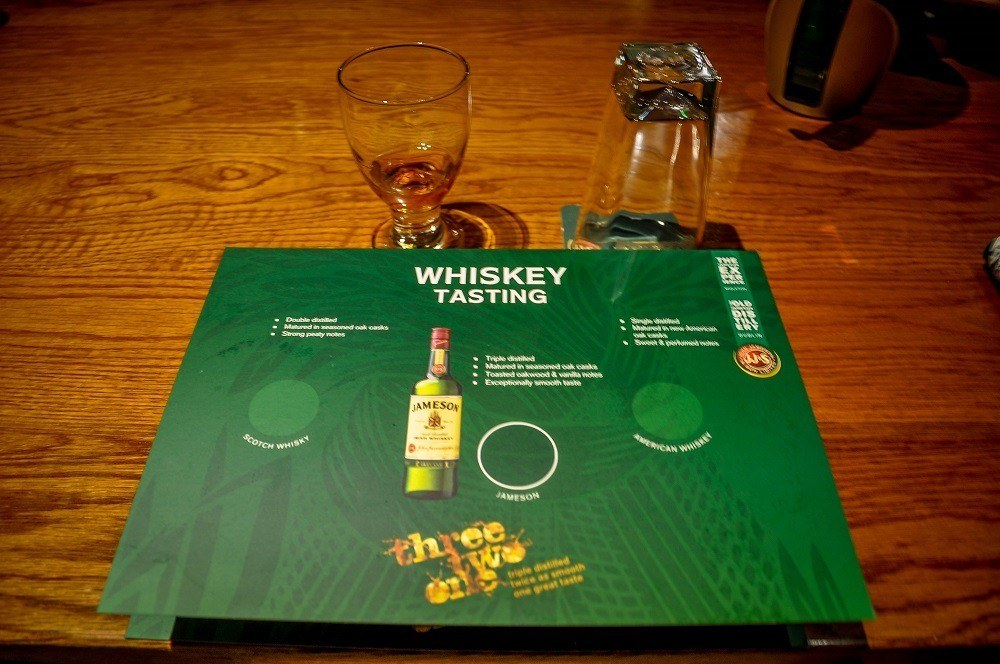 Glass and mat for whiskey tasting at Jameson Distillery