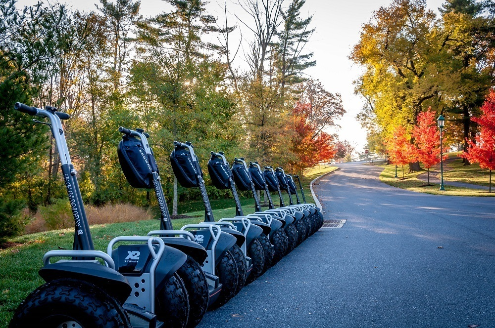A group of Segways lined up on the grounds of the Hershey Hotel