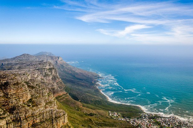 The view from South Africa's Table Mountain is spectacular. Take a look at this 14-day itinerary for South Africa and Victoria Falls.
