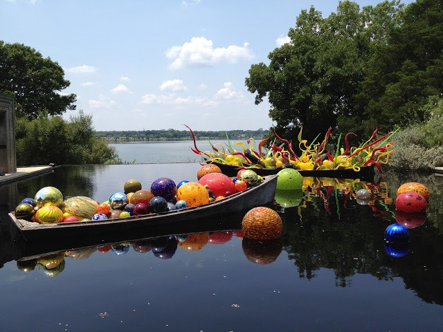 Chihuly glass exhibit of colorful balls in water