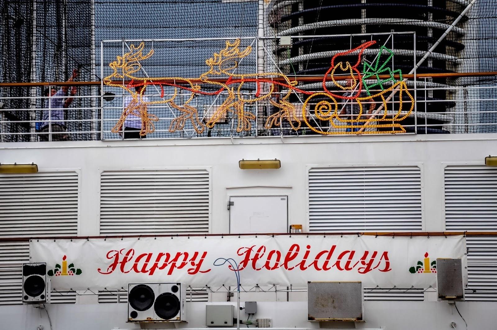 Christmas lights and sign on cruise ship
