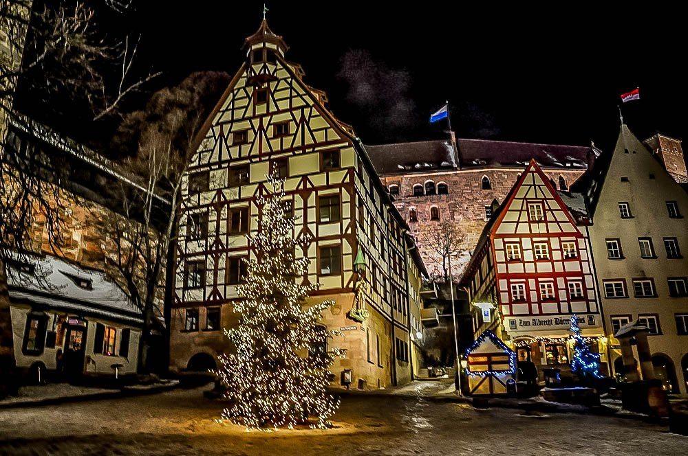 Christmas trees, lights,and half-timber buildings
