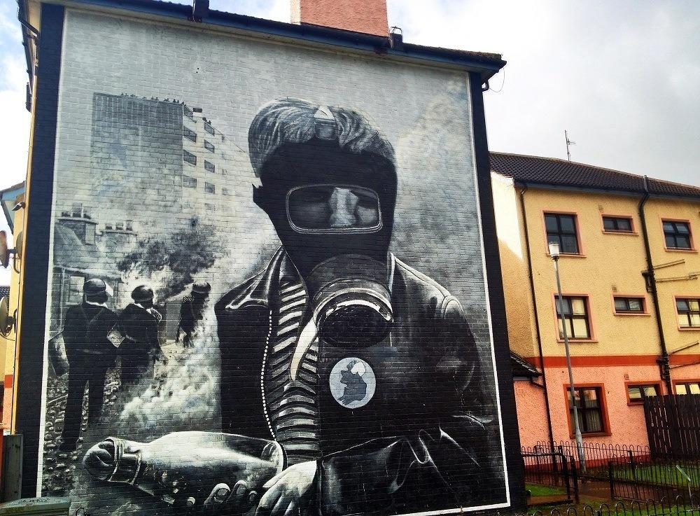 Mural showing man wearing gas mask