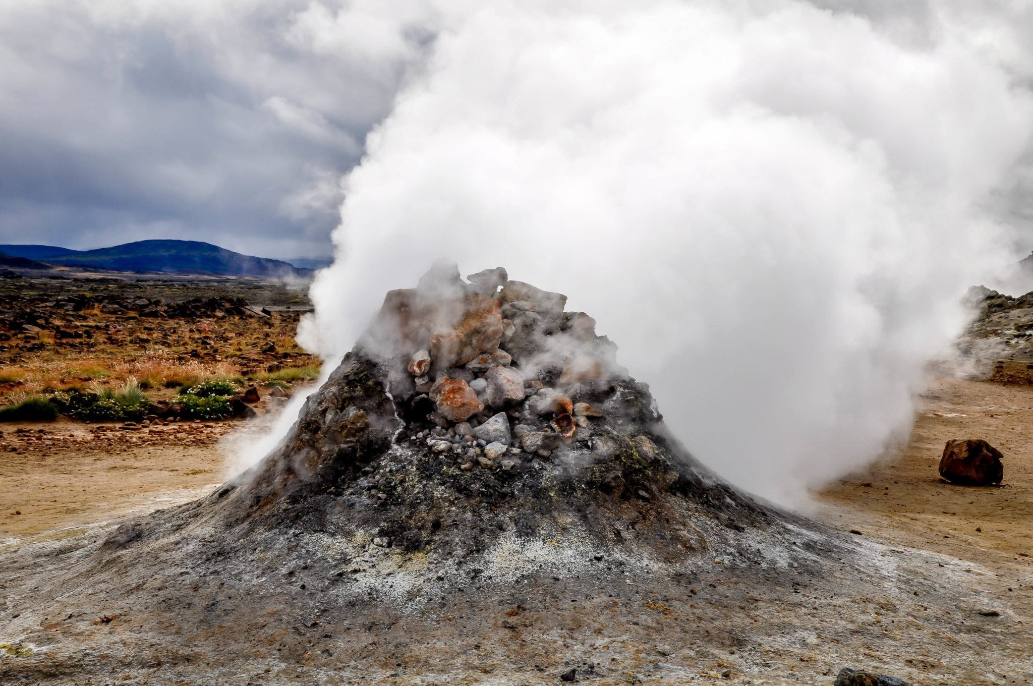 Sulfur gas steaming from a vent in the ground
