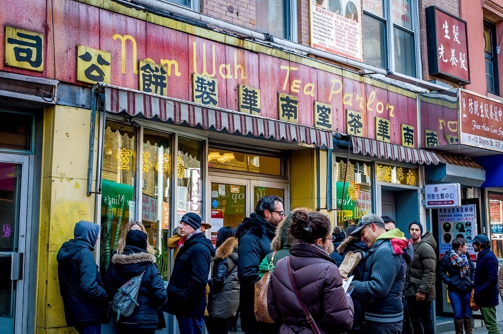 Crowds waiting to experience the original egg roll on a New York food tour at Nom Wah