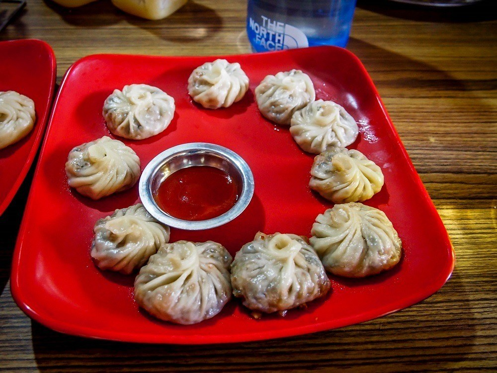 Red plate of MoMo dumplings, the national dish of Nepal