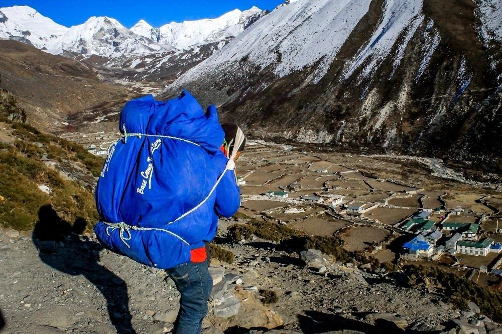 A Sherpa porter in Nepal carrying gear