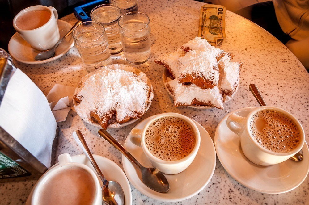 Beignets and coffee on a table