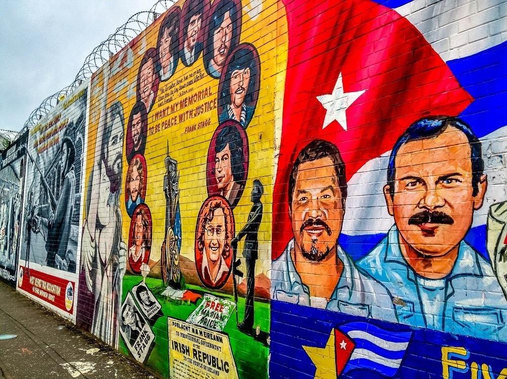 Street art mural showing Cubans and the Cuban flag