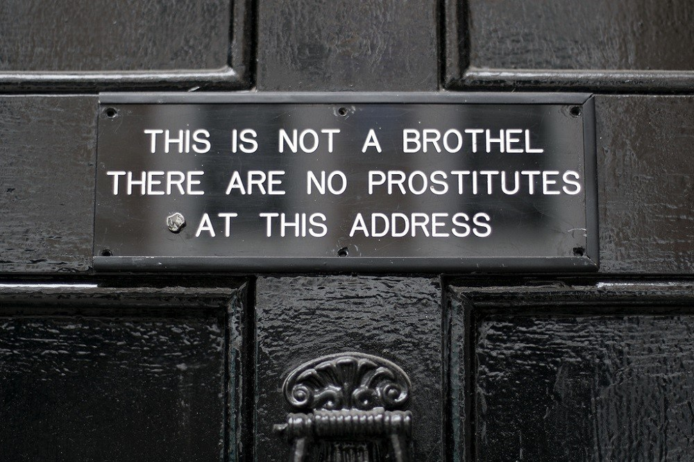 Sign reading: This is not a brothel, there are no prostitutes at this address