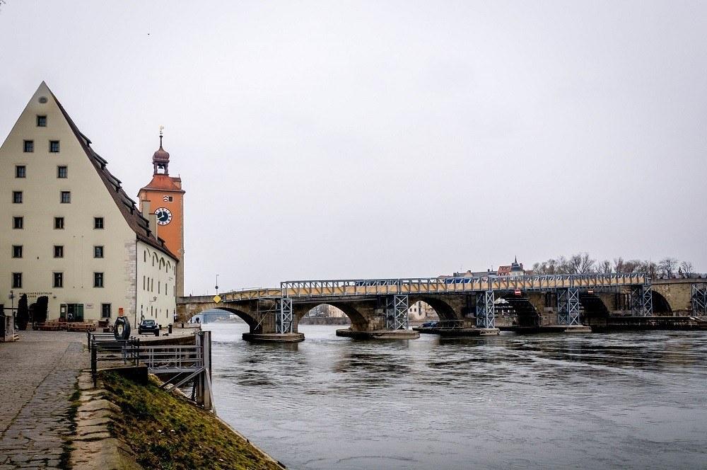 The Danube River is crossed by the Steinerne Brucke (Old Stone Bridge) in Regensburg