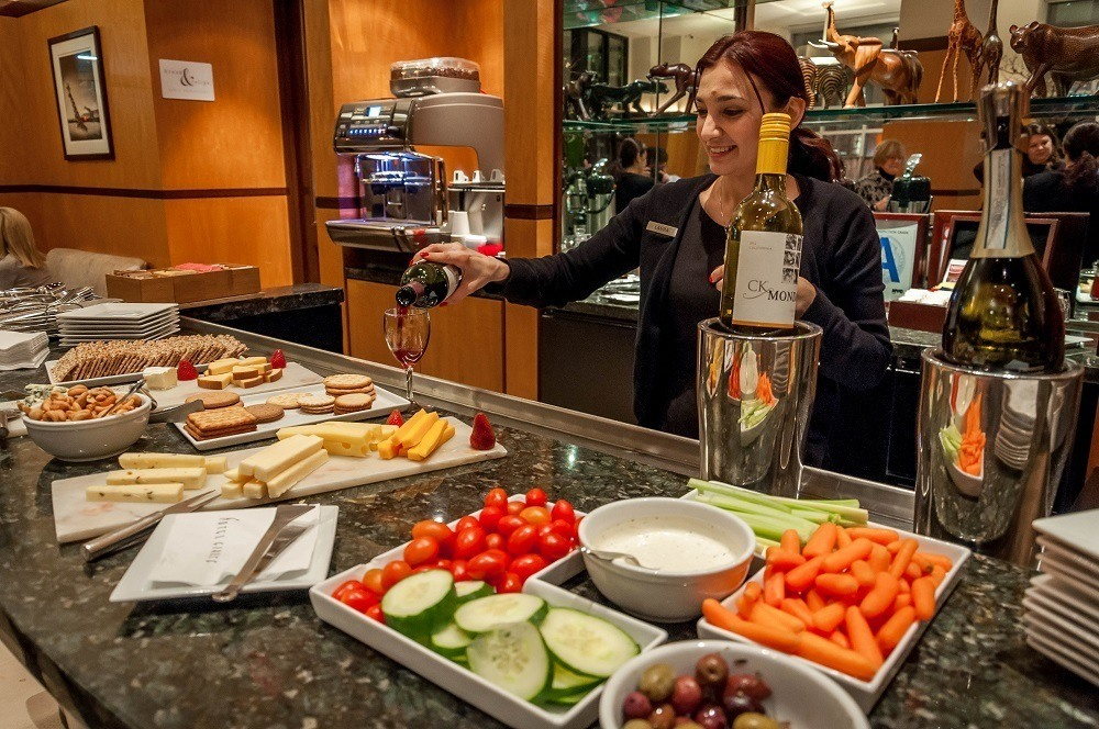 The Hotel Giraffe in New York City features a complimentary happy hour with wines, cheese, and crudites plate