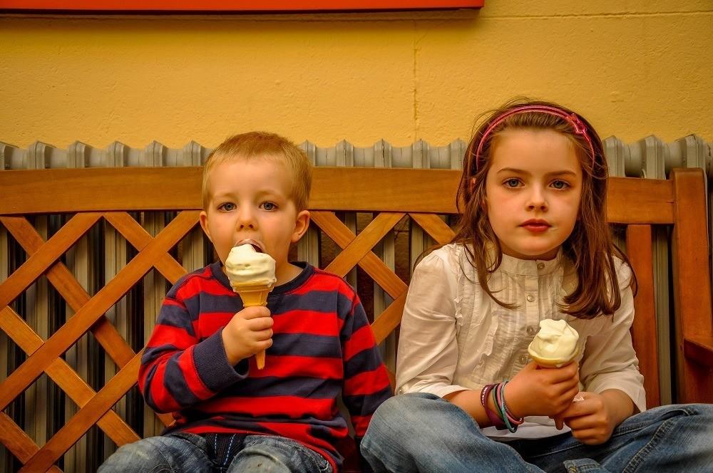 Two young Irish children enjoying their ice cream