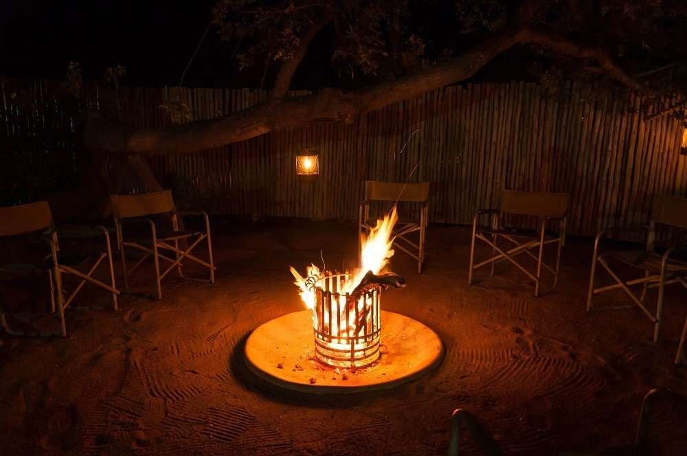 Fire pit with chairs at night