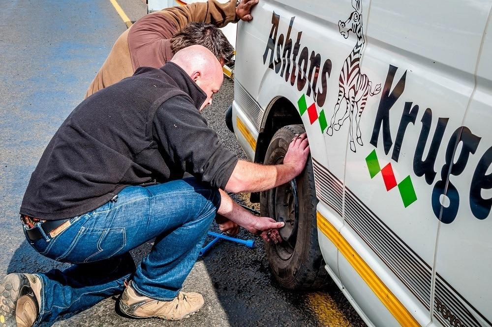 Men fixing a flat tire