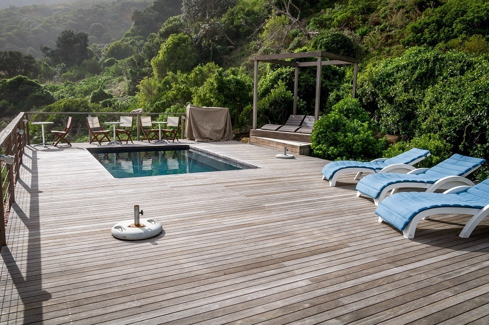 Loungers and chairs by the heated saltwater pool