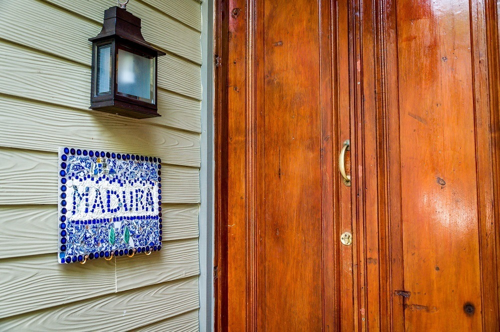 Sign and front door of the Madura suite