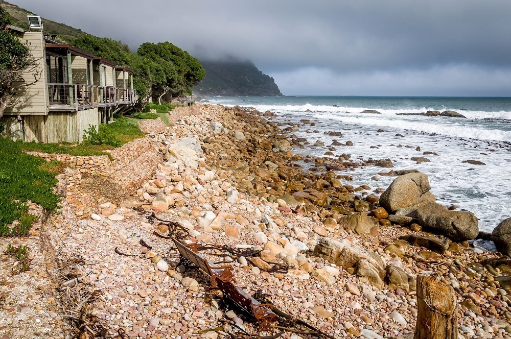 The Tintswalo Atlantic at the edge of the rocky coastline of Hout Bay