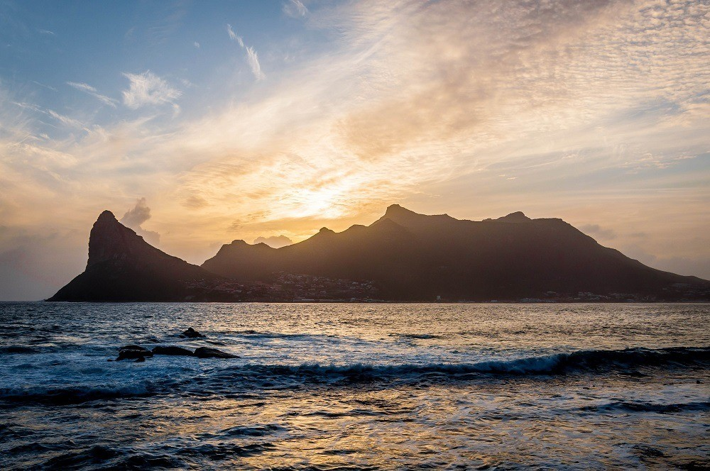 Sunset over Sentinel Peak and Hout Bay from The Tintswalo Atlantic Cape Town lodge
