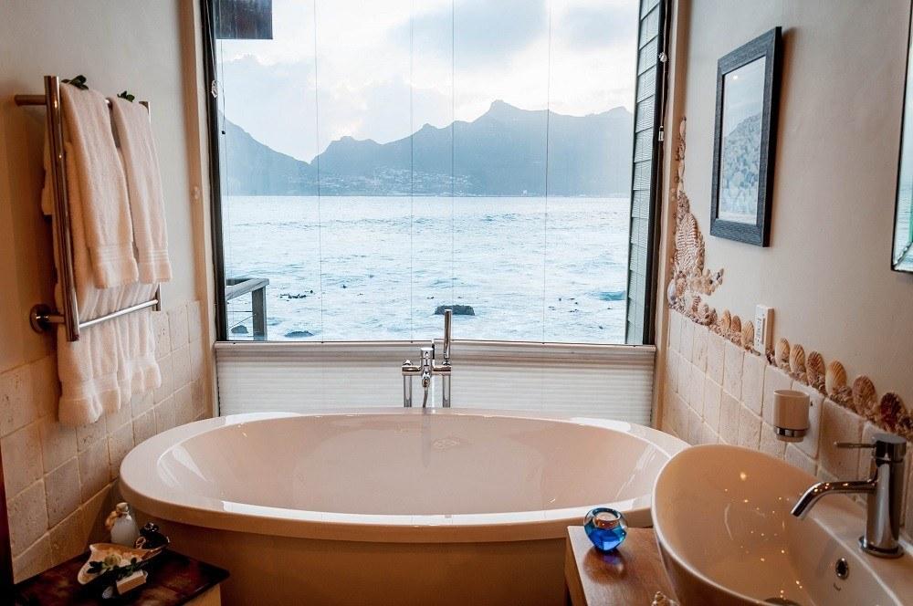 The large soaker bathtub overlooking the ocean