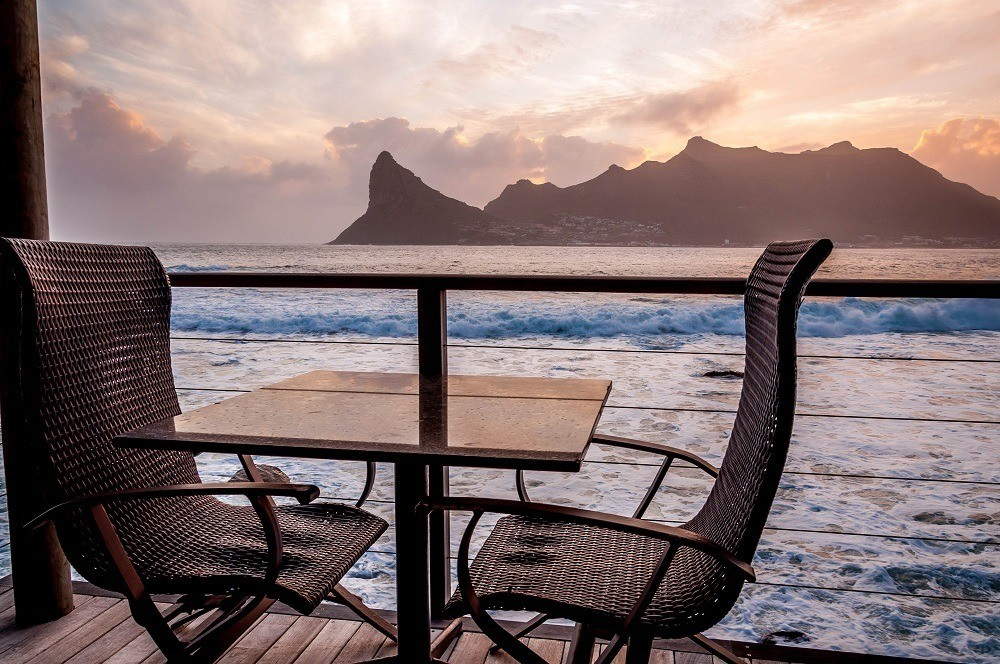 Sunset from our balcony at Tintswalo Atlantic looking out over Hout Bay and Sentinel Peak