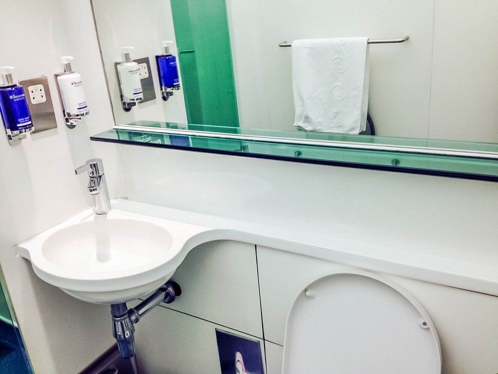 The private showers in the  British Airways lounge at Heathrow Terminal 5. Showers in the BA lounges Heathrow Terminal 5 are private and free for club members or first-class travelers, as well as OneWorld Priority members.