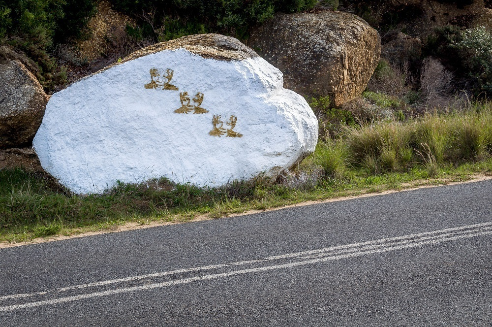 Rock painted with a stenciled portrait of Nelson Mandela