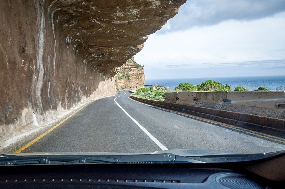 The road on Chapman's Peak Drive is carved into the side of a cliff
