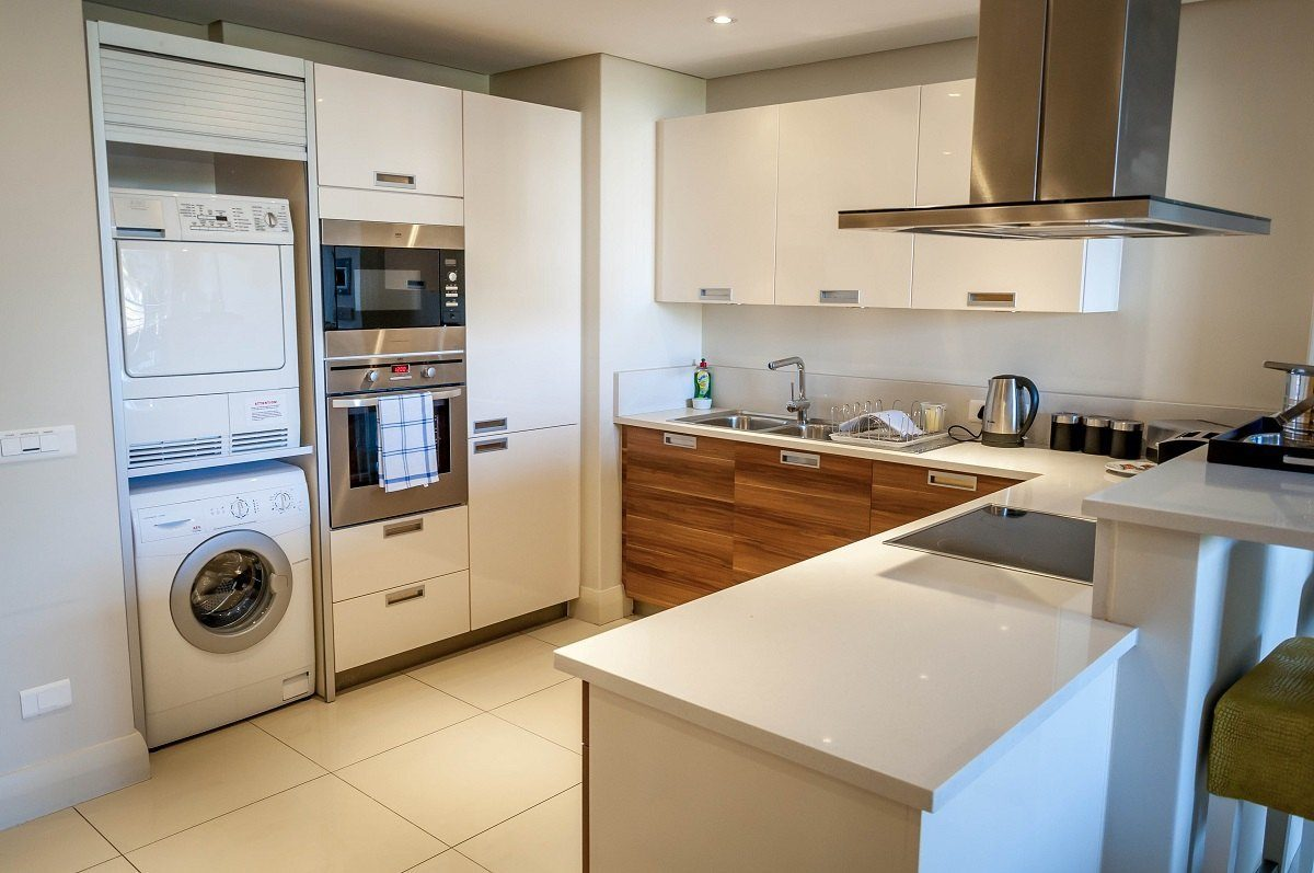 The kitchen, complete with washing machine and dryer.