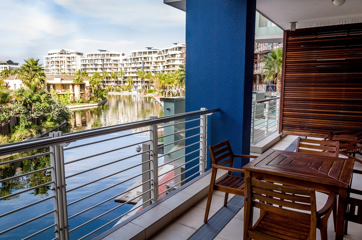 The terrace at the Lawhill Luxury Apartments Cape Town, overlooking the V&A Waterfront canal