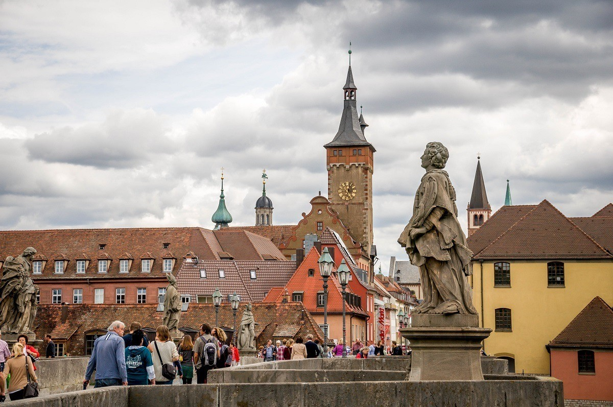 Wurzburg's Old Bridge over the Main River with Town Hall and statues
