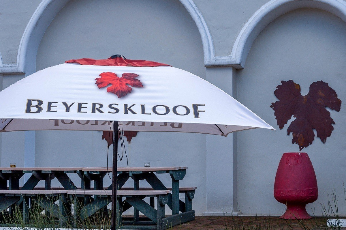 Picnic tables and umbrella at the Beyerskloof winery on the Stellenbosch Wine Route