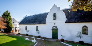 Traditional colonial Dutch architecture at the Morgenhof Estate winery on the Stellenbosch Wine Route.