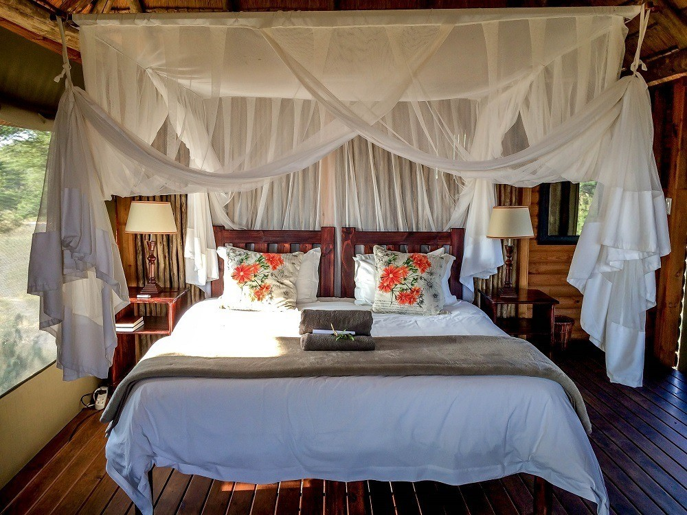 The bedroom in our chalet with mosquito netting at nThambo Tree Camp