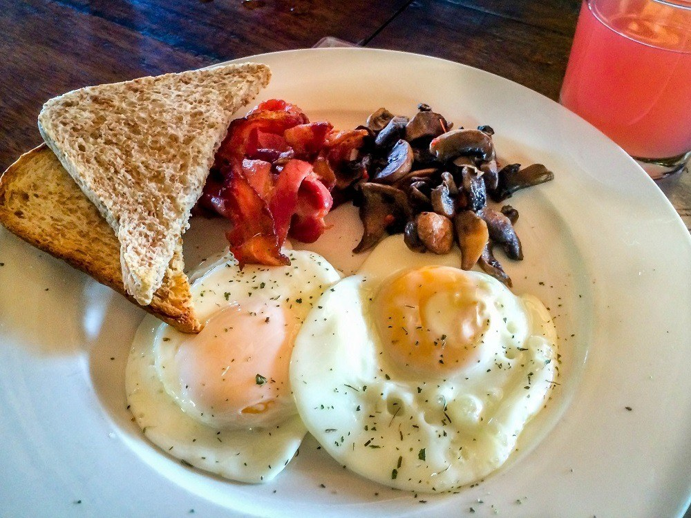 The typical breakfast plate of eggs, toast, and mushrooms at nThambo Tree Camp