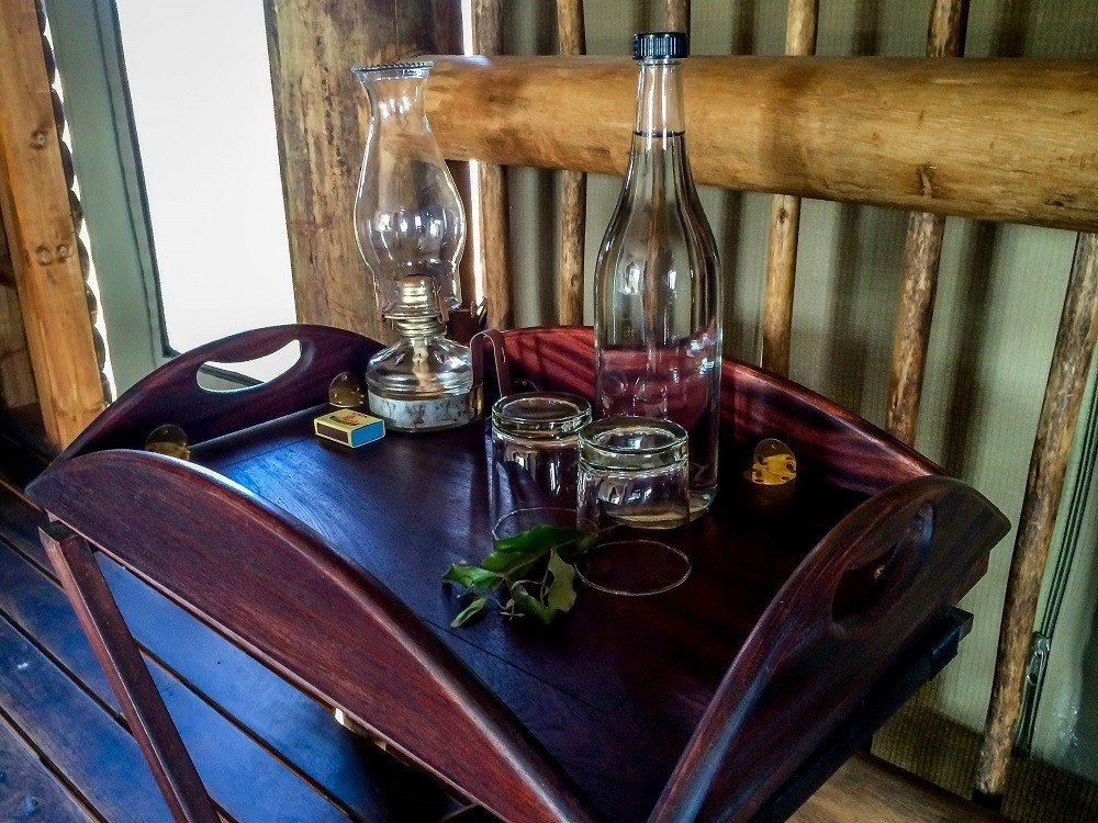 Table in the chalet with oil lamps and water glasses