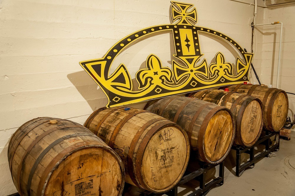Aging barrels in the legendary Beer Vault at Crown Brewery, one of the top Northwest Indiana breweries