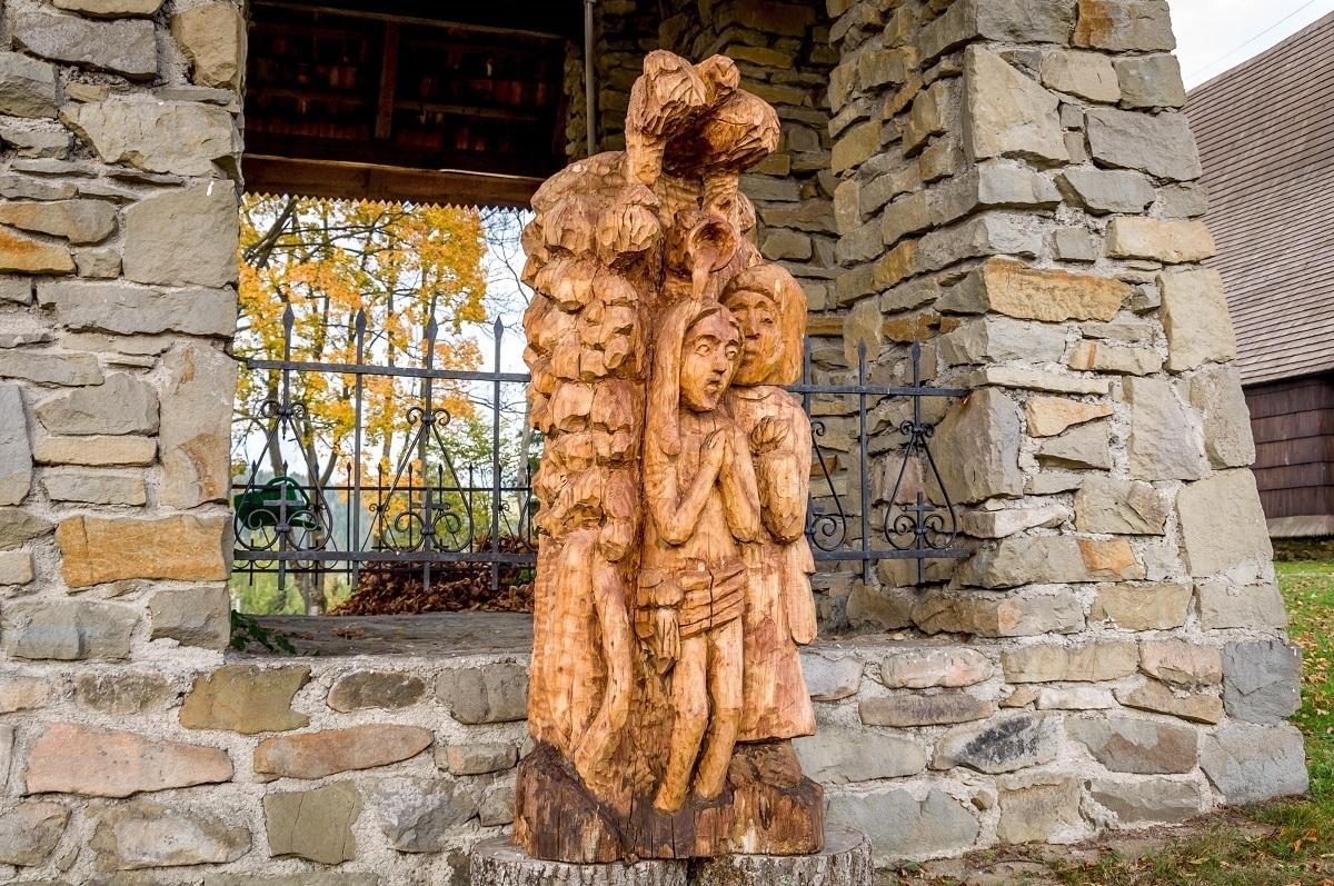 A modern carved sculpture of children
