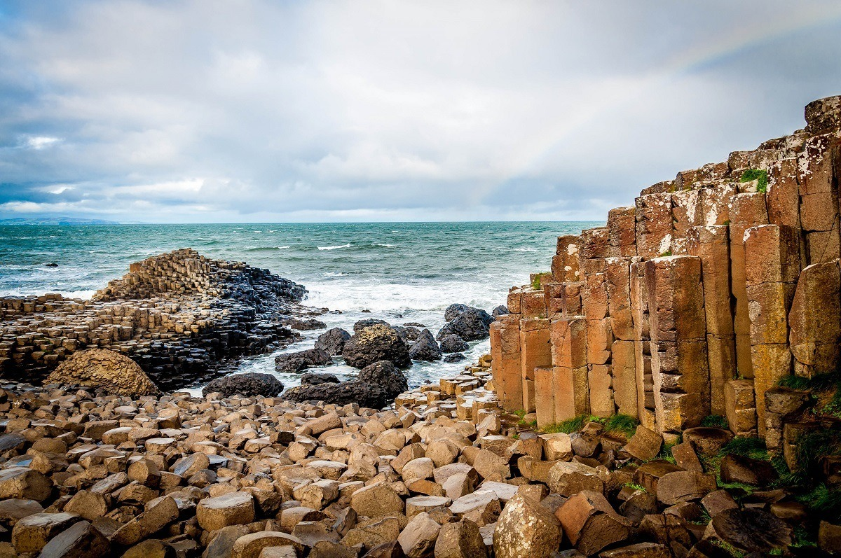 A rainbow over the iconic basalt columns of The Giant's Causeway