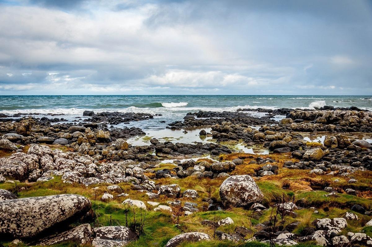 The Causeway Coastal Route explores the rough (but beautiful) Antrim Coast