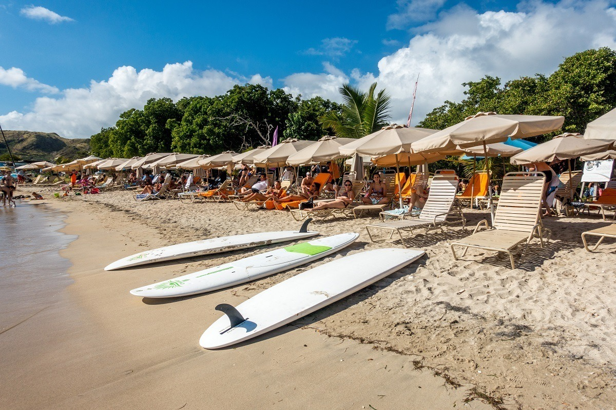 Paddle boards, sun loungers and sun umbrellas at Cockleshell Beach