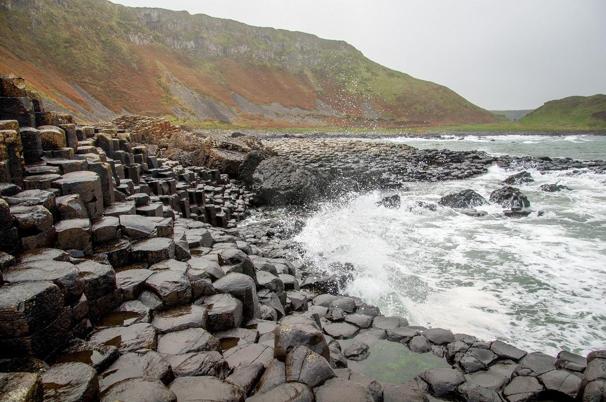 Waves crashing on the rocks at Ireland Giant Causeway