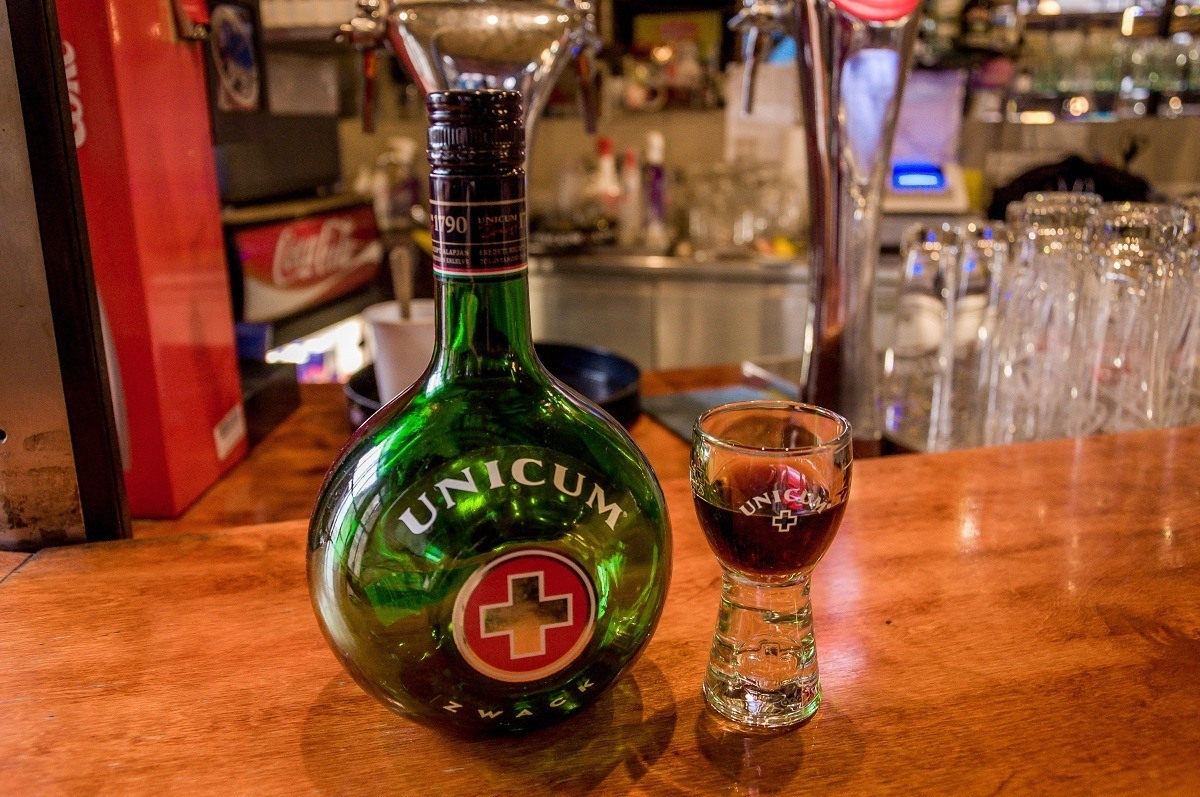 Bottle and glass of Unicum on a bar