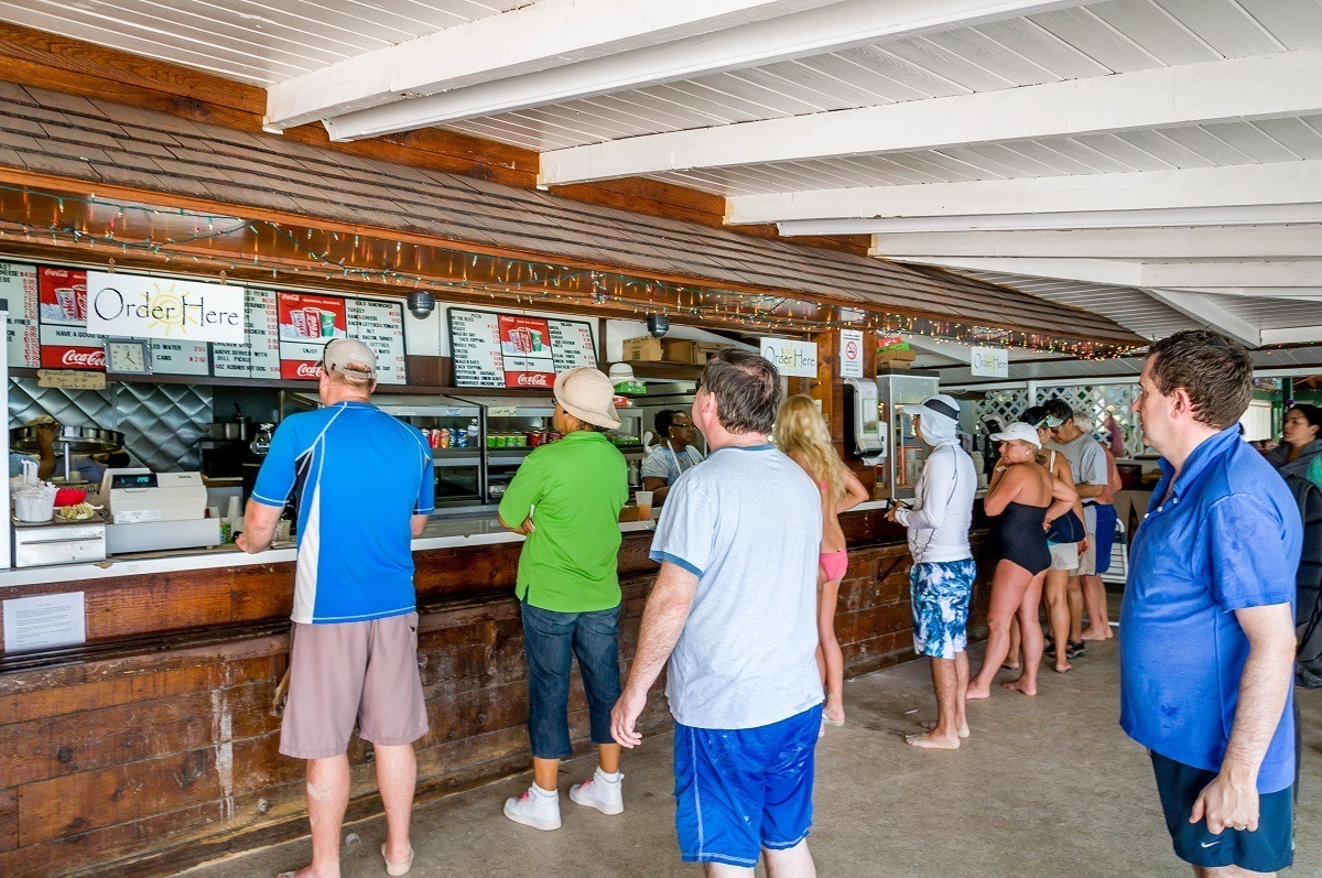 People waiting at a concession stand