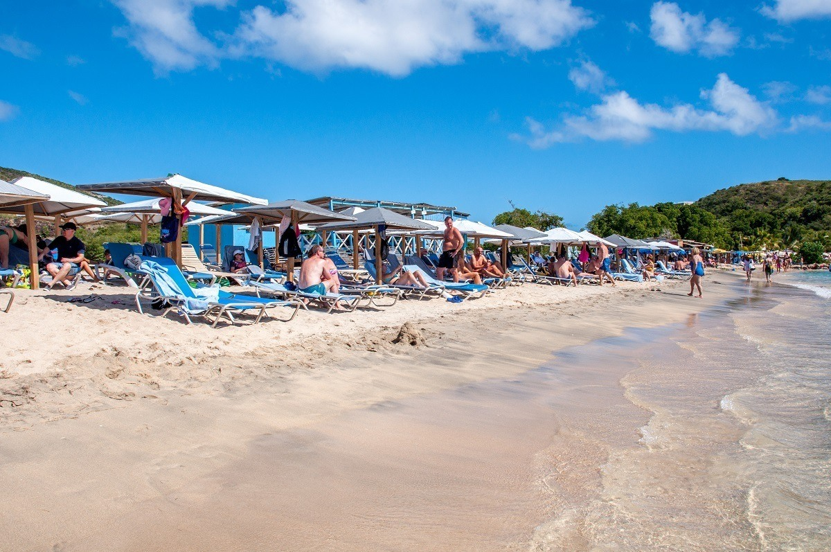 Sun loungers and umbrellas at Mundo Water Sports Bar and Grill on Cockleshell Beach