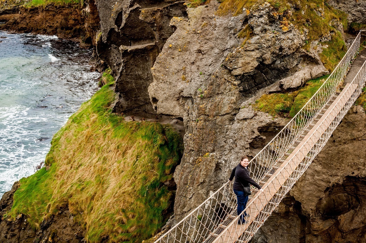 Laura venturing out on the Antrim Coast Road's Carrick-a-Rede rope bridge