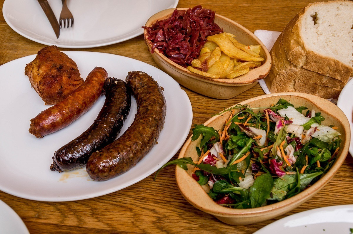 Plate of sausage and salad at the Downtown Pig Feast on a Budapest food tour