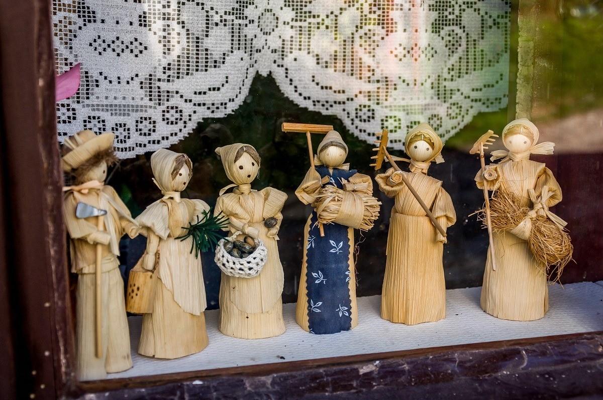 Corn husk dolls in a window