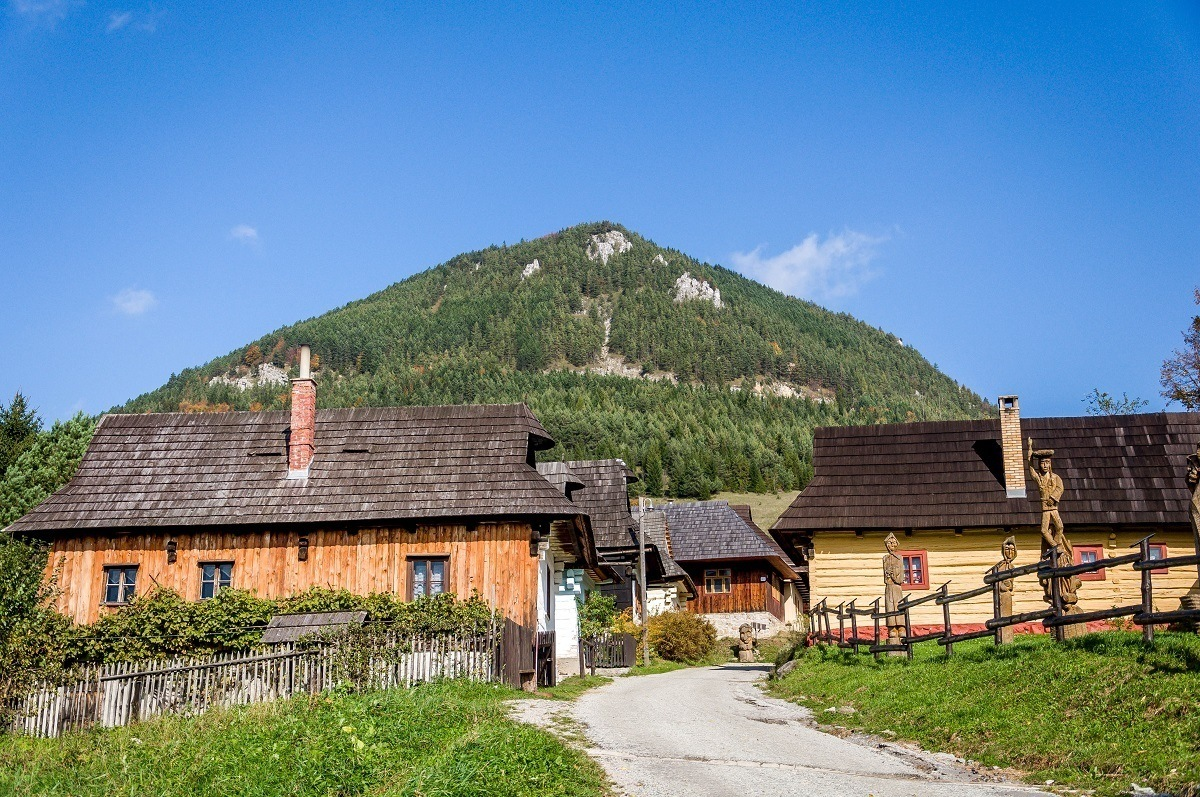 Wooden buildings at the base of a hilll