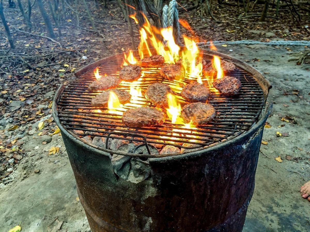 Hamburgers on a charcoal grill